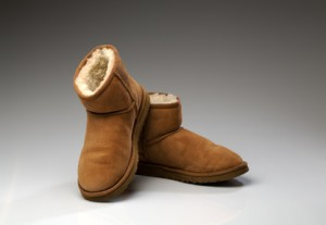 pair of beige uggs with light fur
